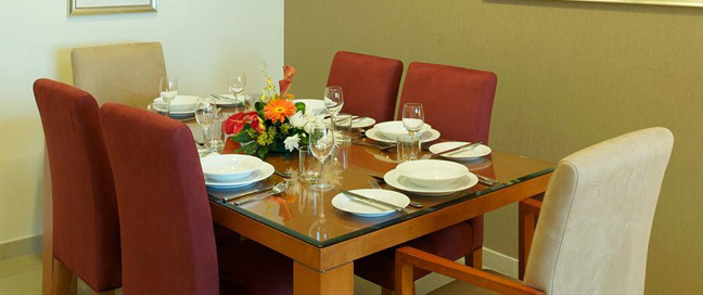 Chelsea Tower Suites & Apartments - Dining Table
